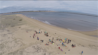 An aerial image of Plum Island (near Newbury and Newburyport, Mass.) shows volunteers  restoring the dunes there.