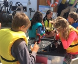 Students aboard UVM's research vessel, the Melosira, try their hands as limnologists. Photo credit: Lake Champlain Sea Grant